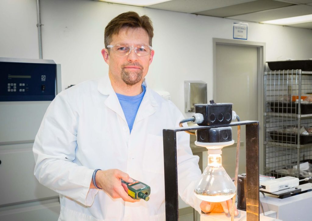scientist in lab with PVC custom compound