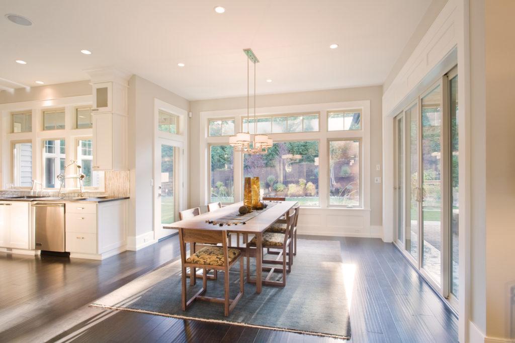 Modern kitchen with many sunshield windows.