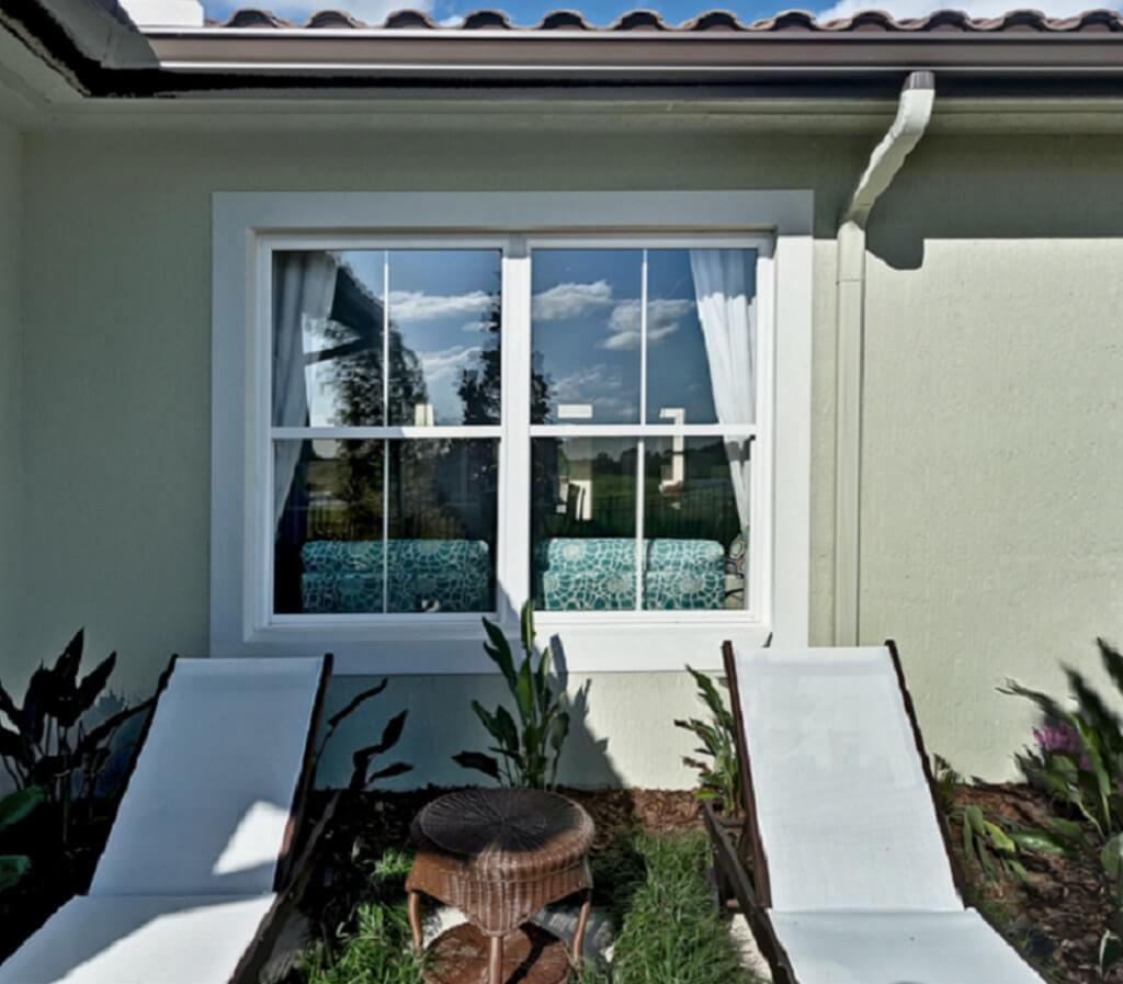 Florida home with two impact window systems installed