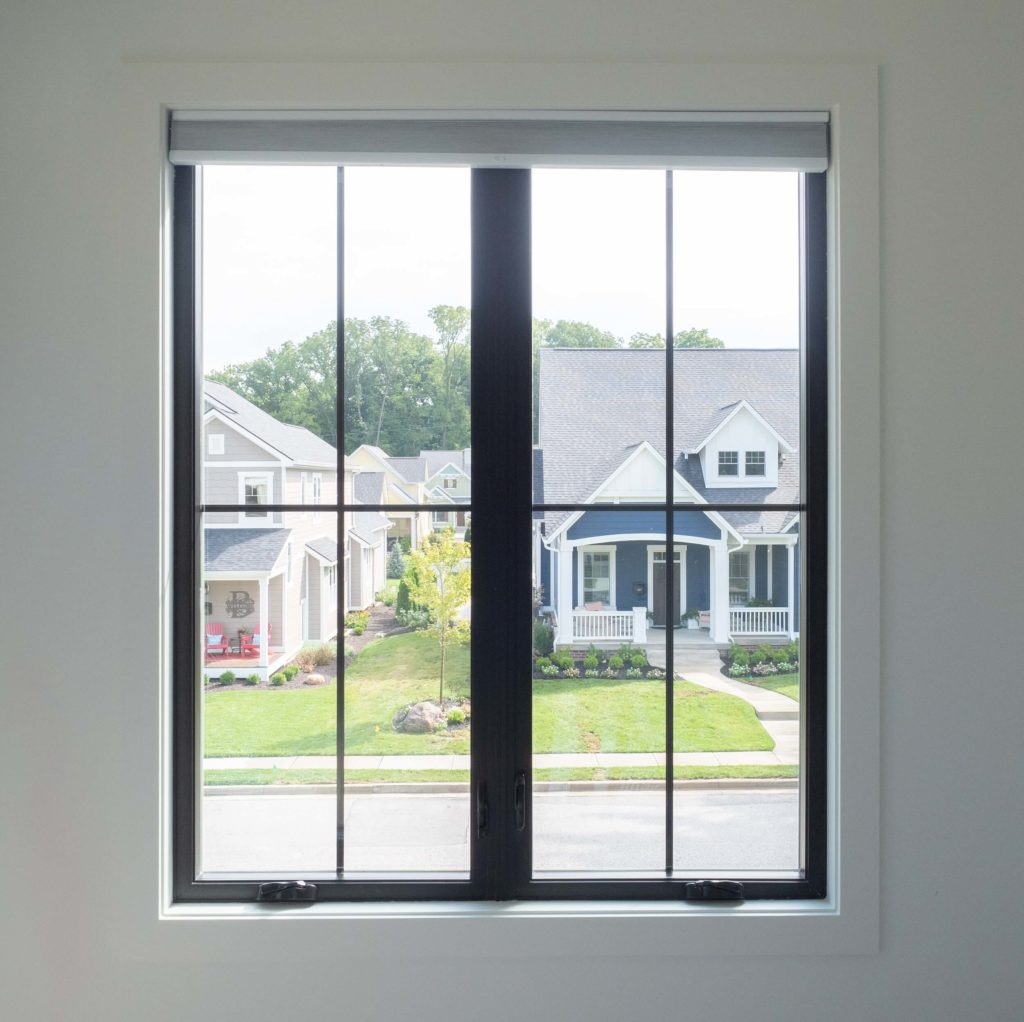 View of street through window made of black colored window profiles